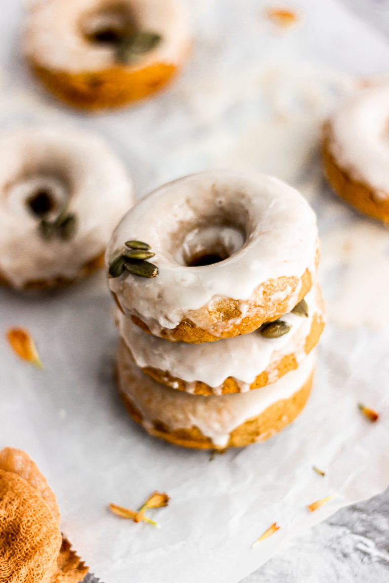 baked pumpkin doughnut with maple glaze