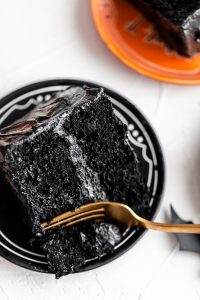chocolate pumpkin cake slice with black frosting
