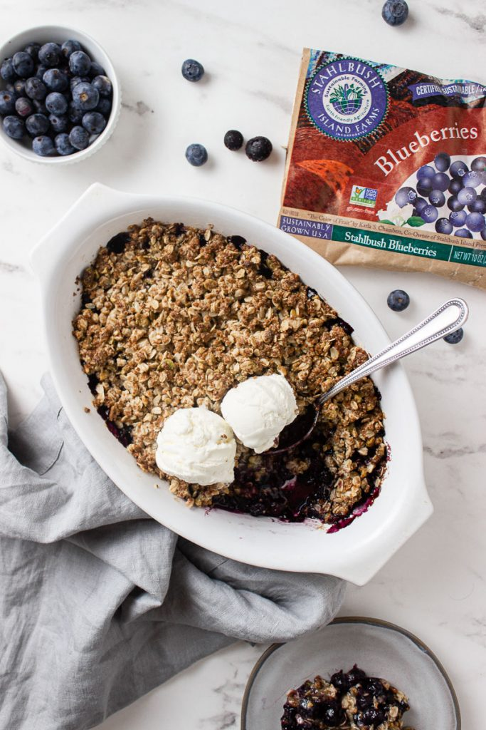 blueberry crisp with vanilla ice cream and frozen blueberries